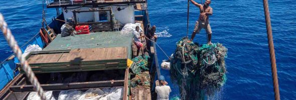 Giant-net-going-into-boat-hold-clean-up-Ocean-Voyages-Institute